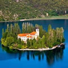 A small island with a Christian monastery on river Krka, Croatia - Europe.